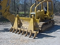 DR-92-8-5X5 rake installed on a dozer