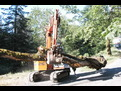 HT1035 hydraulic thumb inst alled on an excavator with a purple bucket