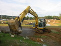 KOBELCO with hydraulic thumb ht1850 picking up a large stone