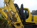 HT1850 hydraulic excavator thumb with black hydraulic cylinder installed on an excavator