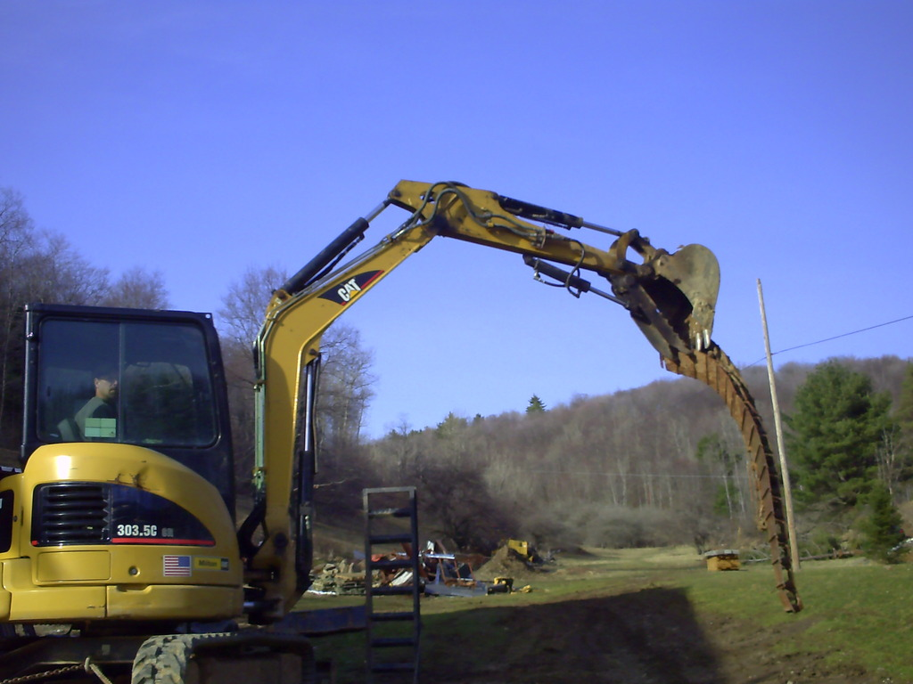 CAT 303.5C CR with hydraulic mini excavator thumb installed by USA Attachments