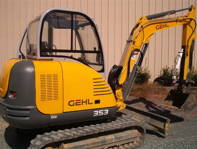 Another view of the HT830 mini excavator thumb installed on GEHL 353 excavator