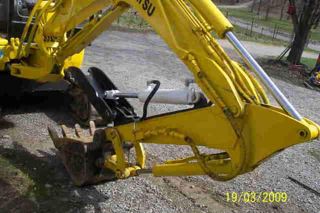USA Attachments presents the HT830 hydraulic excavator thumb installed on a Komatsu excavator