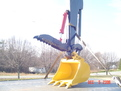 HT830 hydraulic thumb above an excavator bucket
