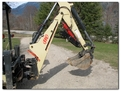 IR backhoe with HT830 mini thumb