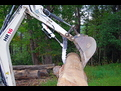 Action shot! HR16 picks up a stone aided by the HT830 mini hydraulic excavator thumb