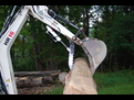 USA Attachments ht830 excavator thumb on a TEREX HR16 mini excavator