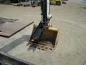 HT830 mini excavator thumb with USA Attachments logo visible