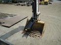 HT830 mini excavator thumb on a pallet doing another pose