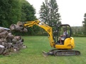 Hydraulic HT830 thumb on a JCB mini excavator