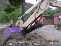 8\&quot;x 30\&quot; excavator thumb in the closed position