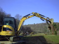 CAT 303.5C CR mini excavator with ht830 hydraulic mini excavator thumb by USA Attachments lifts debris