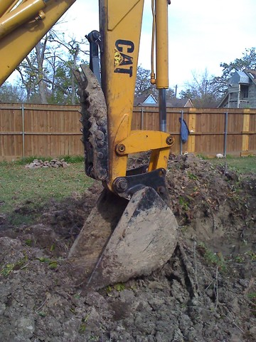 MT1035 excavator thumb installed on a CAT excavator