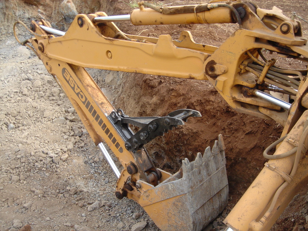 MT1035 excavator thumb installed on a CASE excavator.