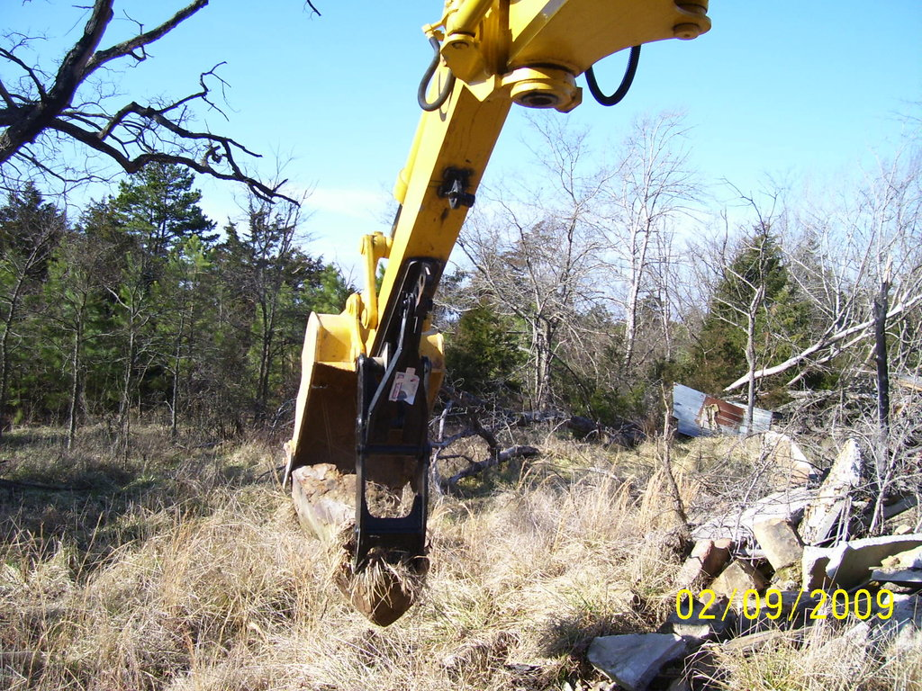 excavator thumb in action! See the mt1240 thumb picking up a large stone. Installed on a KOMATSU PC75UU