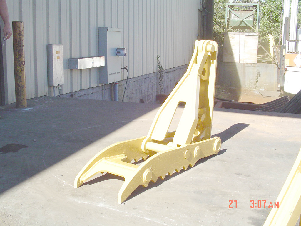 Yellow MT1240 mechanical excavator thumb