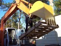 MT1240 excavator thumb picking up a pallet. The bucket in this photo was also made from USA Attachments.
