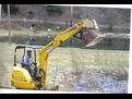 DEERE 27C excavator with a MT1240 excavator thumb, picking up an old tub.
