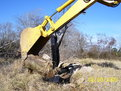 excavator thumb mt1240 thumb in action. Installed on a Komatsu PC75-UU