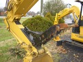 MT1240 excavator thumb installed on a machine.