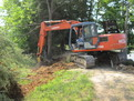 "MT1850, 18"" x 50"" excavator thumb installed on HITACHI EX120 by USA Attachments"
