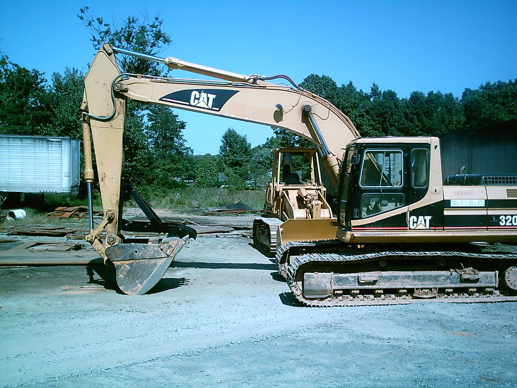 Cat excavator with MT2458 thumb at USA Attachments.