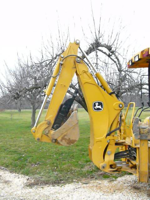 MT618 mini thumb installed on a deere compact loader backhoe