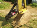 "An 6"" x 18"" mini thumb installed on a Terramite T5C compact loader backhoe."