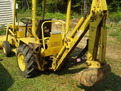 Terramite T5C compact loader backhoe with MT618 mini thumb by USA Attachments