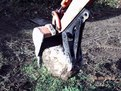 "6""x18"" mini thumb on Kubota kh-41 mini excavator grasps a stone"