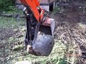 "MT618, 6""x18"" mini thumb installed on a Kubota KH-41 mini excavator picking up a stone"