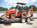 Kubota L35 tractor backhoe  with MT824 mini thumb by USA Attachments