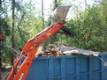 RARRRRRGH! The Kubota L35 tractor backhoe with a MT824 thumb from USA Attachments.