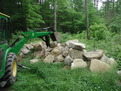 Deere mini backhoe farm tractor with mt824 thumb moving stone