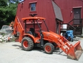 "8"" x 24\"" thumb installed on a Kubota L39 backhoe"