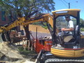 CAT 303 SR mini excavator thumb removing concrete with MT830 mini thumb