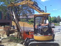 CAT 303 SR with mini excavator thumb lifts concrete slab in Australia