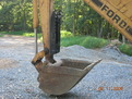 "Ford backhoe with MT830, 8""x30"" mini thumb"