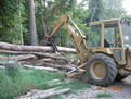 "FORD loader BACKHOE with 8""x30"" thumb picks up log"