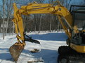 komatsu mini excavator with mt830 thumb in the snow