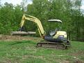 "8"" x 30"" excavator thumb installed on a Komatsu PC40 excavator"