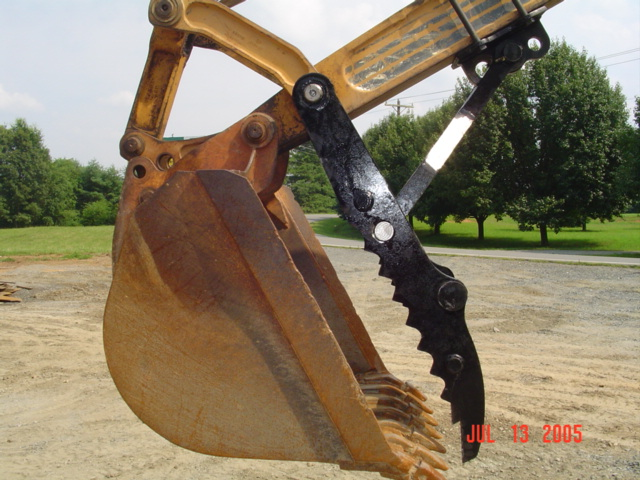 Pin on mechanical thumb for  CASE 580 K, L, M, backhoe with ductile stick.