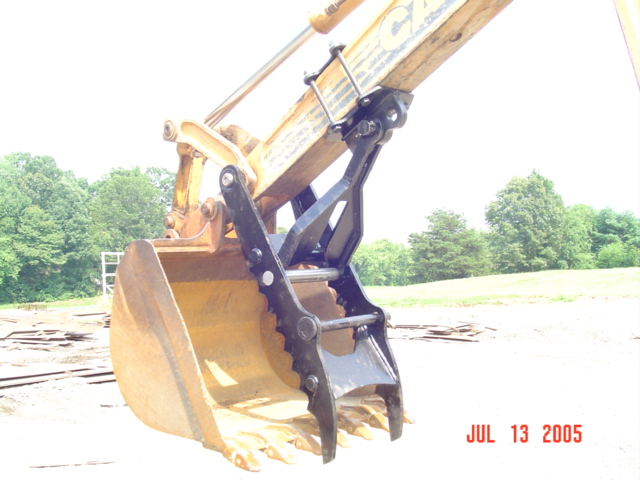 CASE 580 K, L, M with backhoe thumb. Our backhoe thumb just pins on.