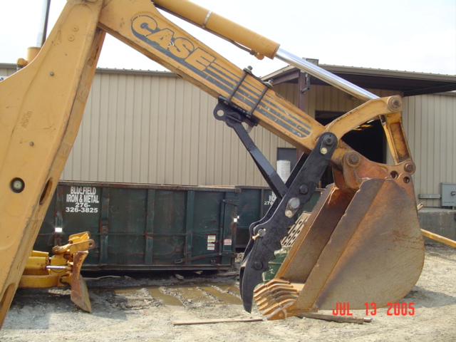 case 580 k,l,m with pin on backhoe thumb