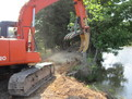 Stumper on hitachi ex120 clearing a path